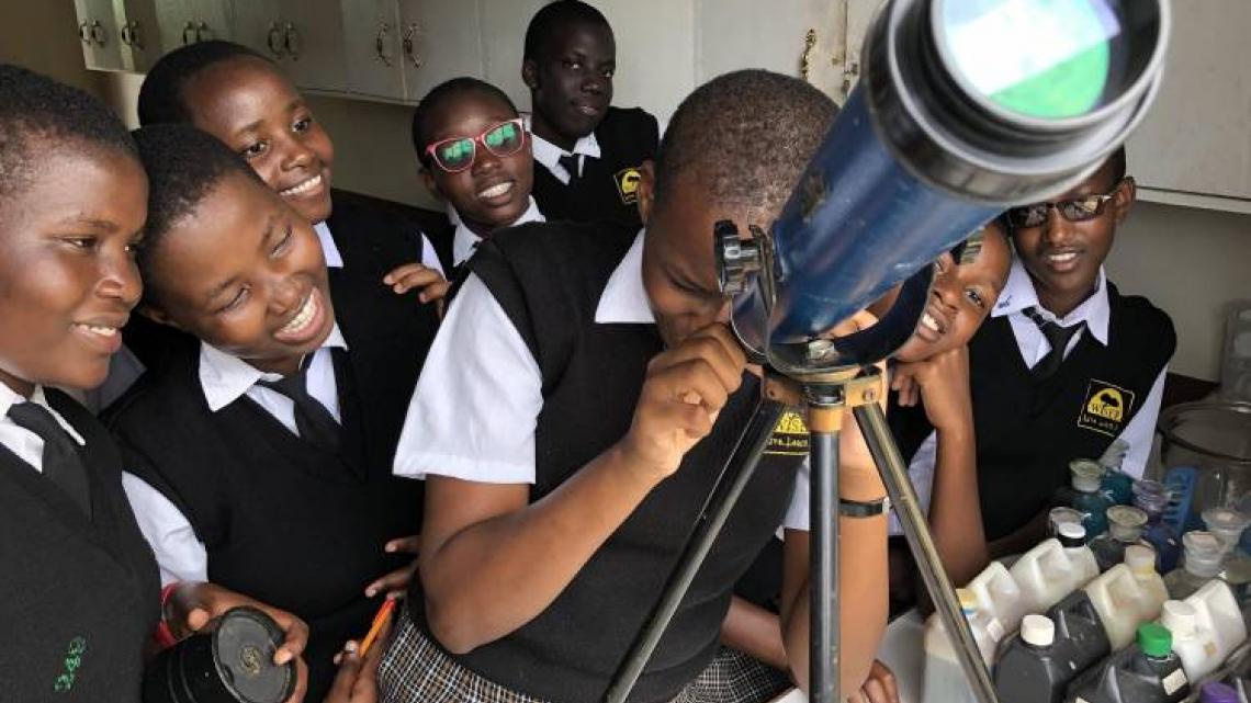 Students gathered around telescope. Photo by Zack Fowler, 2020